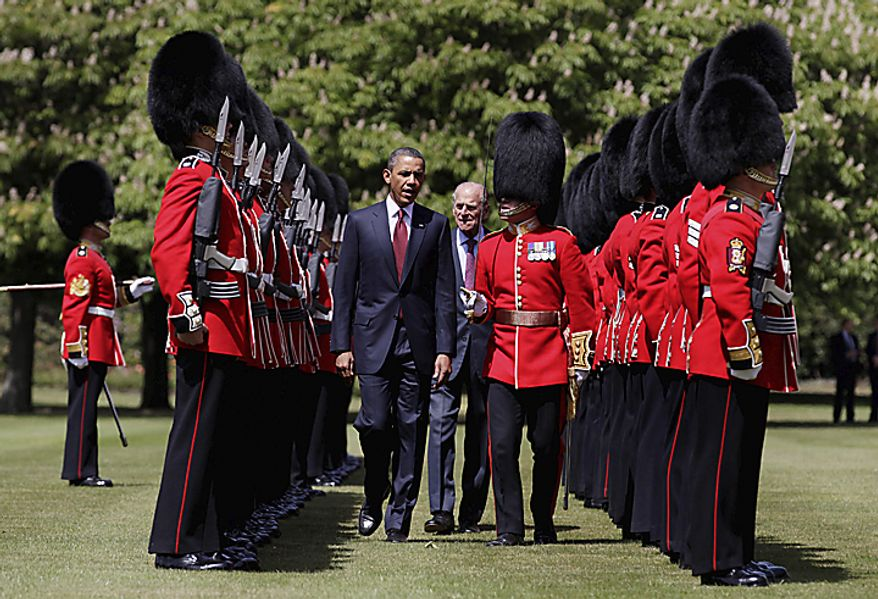 President Obama (center left) and Prince Philip (center) review a Guard of Honor of the Scots Guard sduring an official arrival ceremony at Buckingham Palace in London on Tuesday, May 24, 2011. (AP Photo/Carolyn Kaster)