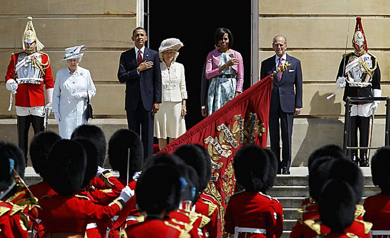 Britain's Queen Elizabeth II (second from left); President Obama; Camilla, Duchess of Cornwall, who is Prince Charles' wife; first lady Michelle Obama; and Prince Philip, the queen's husband, take part in the official welcome ceremony outside Buckingham Palace with a honor guard from the Scots Guards at the start of the president's  state visit in London on Tuesday, May, 24, 2011. (AP Photo/Alastair Grant)