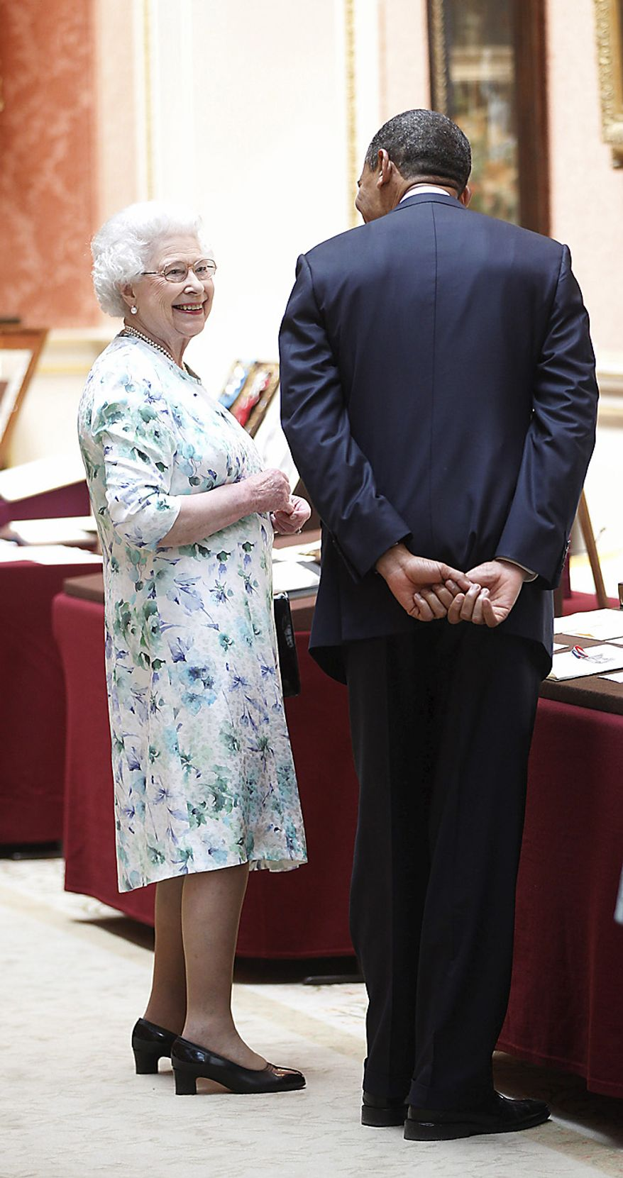 President Obama talks with Britain's Queen Elizabeth II during a tour of the Queen's Gallery at Buckingham Palace in London on Tuesday, May 24, 2011. (AP Photo/Charles Dharapak)