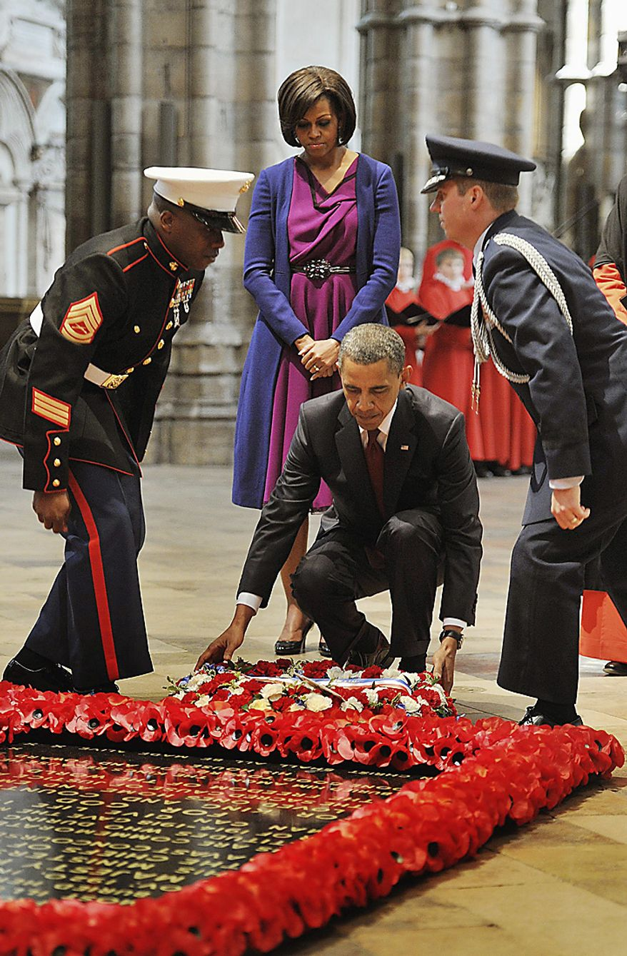 President Obama (center right), watched by his wife, first lady Michelle Obama, lays a wreath at the grave of the Unknown Warrior during a tour of Westminster Abbey in central London on Tuesday, May 24, 2011, on his two-day state visit to the United Kingdom. (AP Photo/PA, John Stillwell)