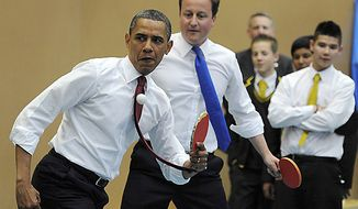 President Obama (left) and British Prime Minister David Cameron play table tennis at Globe Academy in south London on May 24, 2011. (Associated Press)