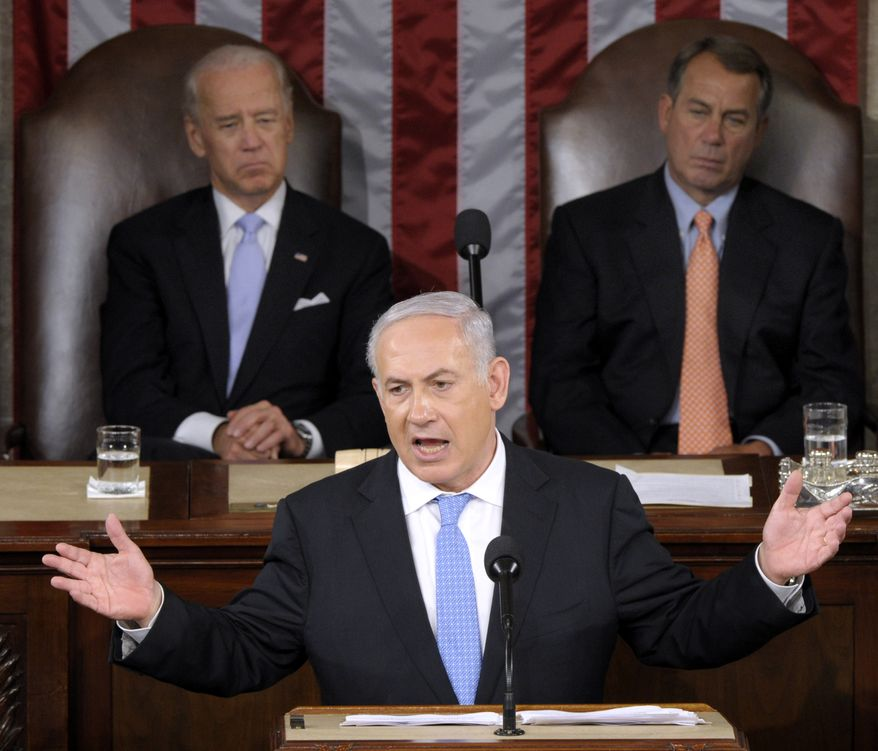 Israeli Prime Minister Benjamin Netanyahu addresses a joint meeting of Congress on Capitol Hill in Washington on Tuesday, May 24, 2011. Behind him are Vice President Joseph R. Biden Jr. (left) and House Speaker John  A. Boehner. (AP Photo/Susan Walsh)