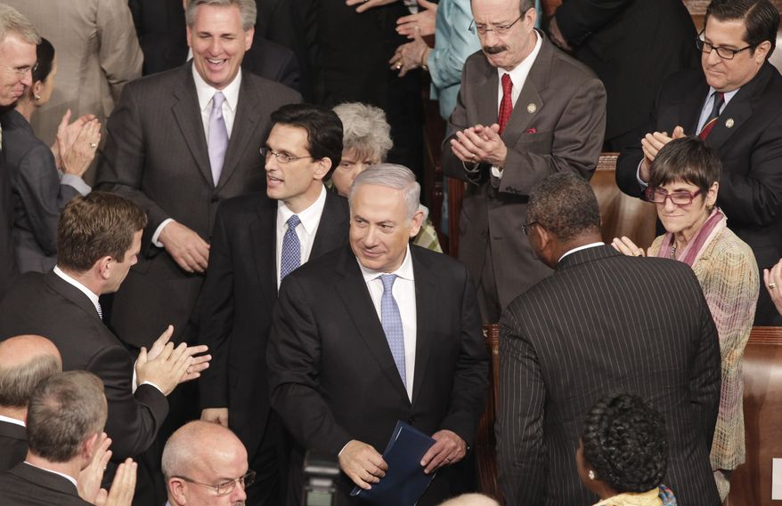 Israeli Prime Minister Benjamin Netanyahu (center front), followed by House Majority Leader Eric Cantor and House Majority Whip Kevin McCarthy, arrives at the Capitol to address a joint meeting of Congress on Tuesday, May 24, 2011, in Washington. (AP Photo/J. Scott Applewhite)