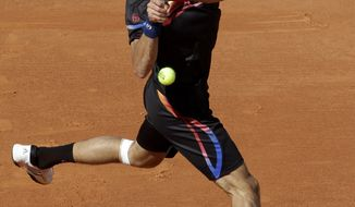 Serbia's Novak Djokovic returns the ball to Romania's Victor Hanescu during their second round match of the French Open tennis tournament, at the Roland Garros stadium in Paris, Wednesday, May 25, 2011. Djokovic was serving at 6-4, 6-1, 2-3, 30-love when Hanescu decided to stop playing. (AP Photo/Lionel Ciro