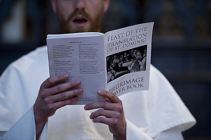 A Catholic friar of the Dominican order sings hymns from the pilgrimage prayer book before he and 13 other friars headed out on a pilgrimage on Tuesday, May 24, 2011, from the Dominican House of Studies in Northeast Washington to St. Dominic's Parish in Southwest. This is the first time the friars have held the pilgrimage, which commemorated the date that St. Dominic's body was moved from its original grave to its current resting place in Bologna, Italy. Each of the friars was instructed to have a personal intention for the pilgrimage. (Barbara L. Salisbury/The Washington Times)