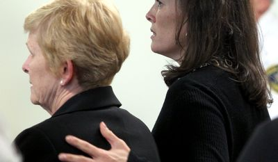 Former Olympic figure skater Nancy Kerrigan (right) rubs her mother, Brenda's back during her brother's trial on  involuntary manslaughter charges in Woburn, Mass., on Tuesday, May 24, 2011. (AP Photo/Bill Greene, Pool)