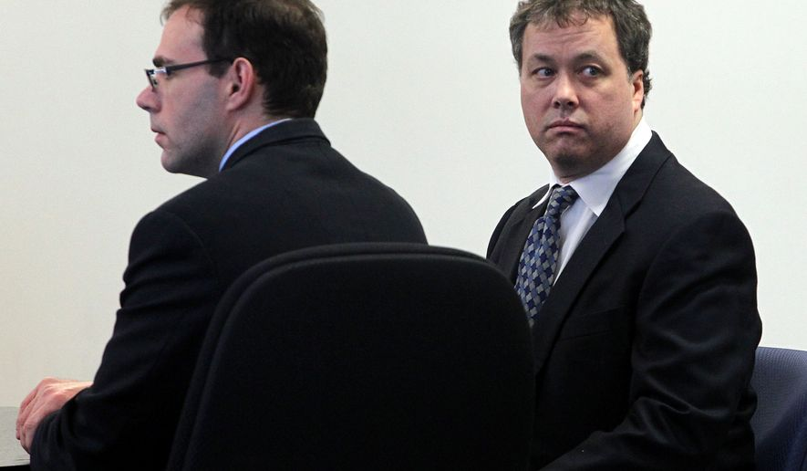 Mark Kerrigan (right), with defense attorney Hank Brennan, looks at his family during his involuntary manslaughter trial in Middlesex Superior Court in Woburn, Mass., on Tuesday, May 24, 2011. (AP Photo/Bill Greene, Pool)