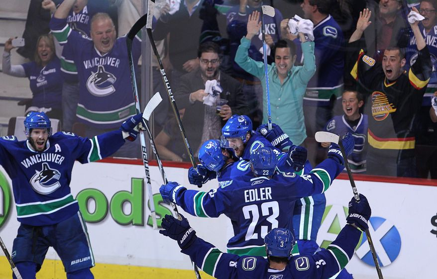 NHL Playoffs: Vancouver Canucks' Ryan Kesler, left, celebrates his game-tying goal against the San Jose Sharks during the third period of Game 5 of NHL hockey Stanley Cup playoffs Western Conference finals Tuesday, May 24, 2011, in Vancouver, British Columbia. (AP Photo/The Canadian Press, Jonathan Hayward)
