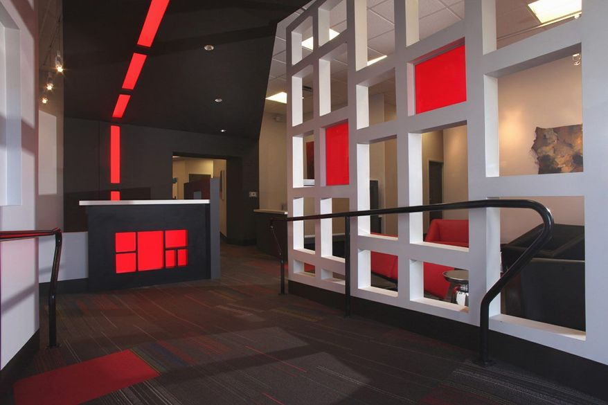 This undated photo courtesy of Troy Glasgow shows the entrance to Gibson Hall at the Memphis College of Art in Overton Park in Memphis, Tenn. In designing the new entrance to Gibson Hall, the college's administrative building, Askew Nixon Ferguson Architects wanted to highlight the color red, a signature color for the college. LuciteLux acrylic was chosen for its translucent properties and its unique look when illuminated. (AP Photo/Troy Glasgow)