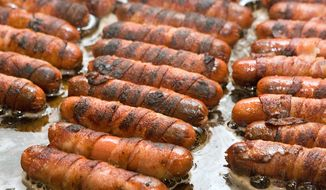 The roughly 782 Democrats running for the presidency are like the hot dog vendors of yesteryear, stressing not what makes them different but just how similar they are to the rest of the field. (Associated Press/File)