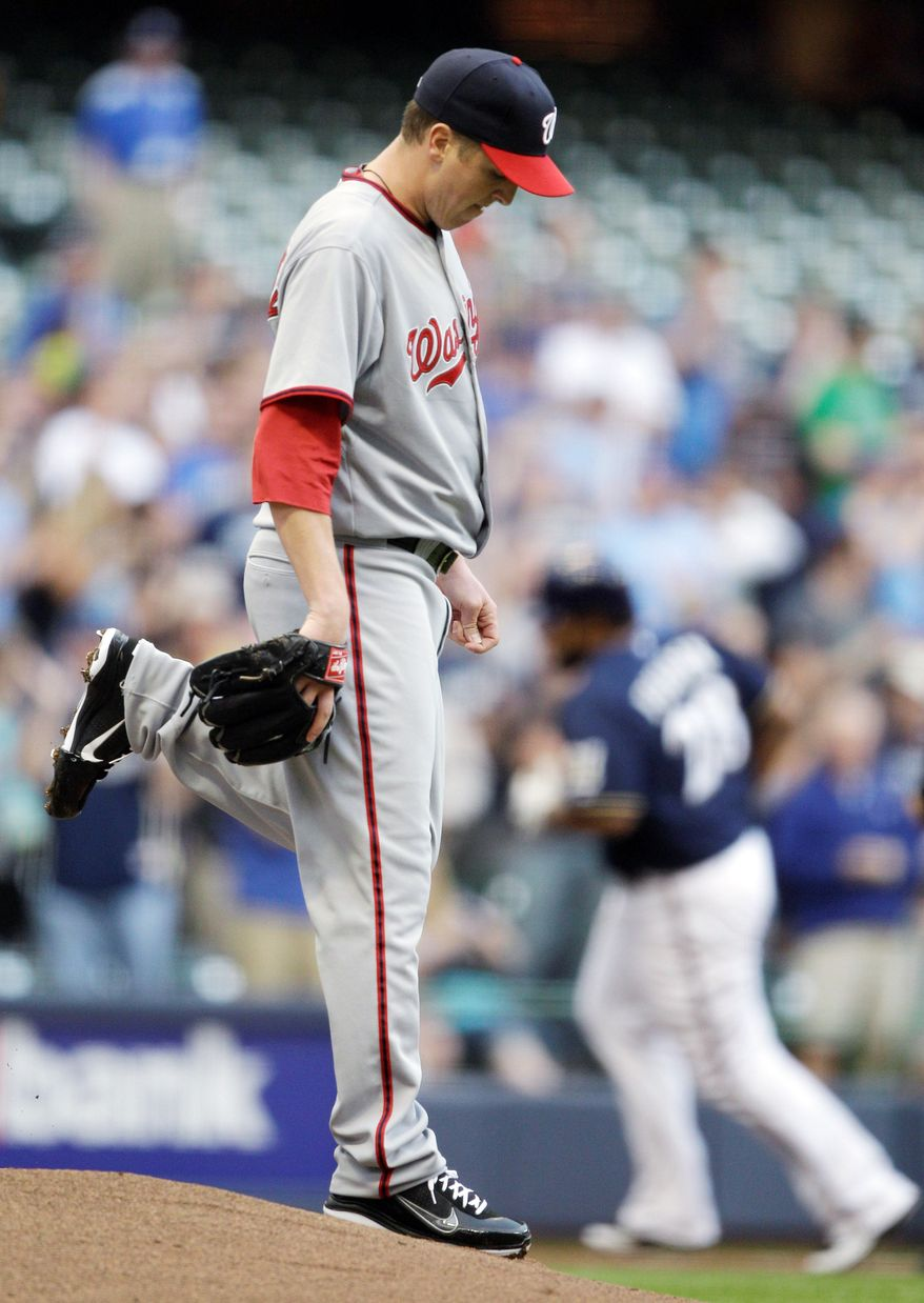 ASSOCIATED PRESS Nationals left-hander Tom Gorzelanny showed his disgust after allowing a home run in the Brewers' 11-3 win Monday night.
