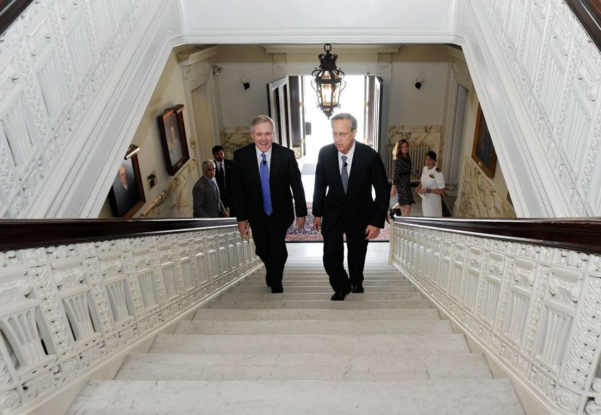 Navy Secretary Ray Mabus (left) and Yale President Richard Levin arrive Thursday to sign an agreement to establish the Naval ROTC's formal presence at Yale University in New Haven, Conn. The ROTC unit at Yale will be the Navy's only ROTC unit in Connecticut. (Associated Press)