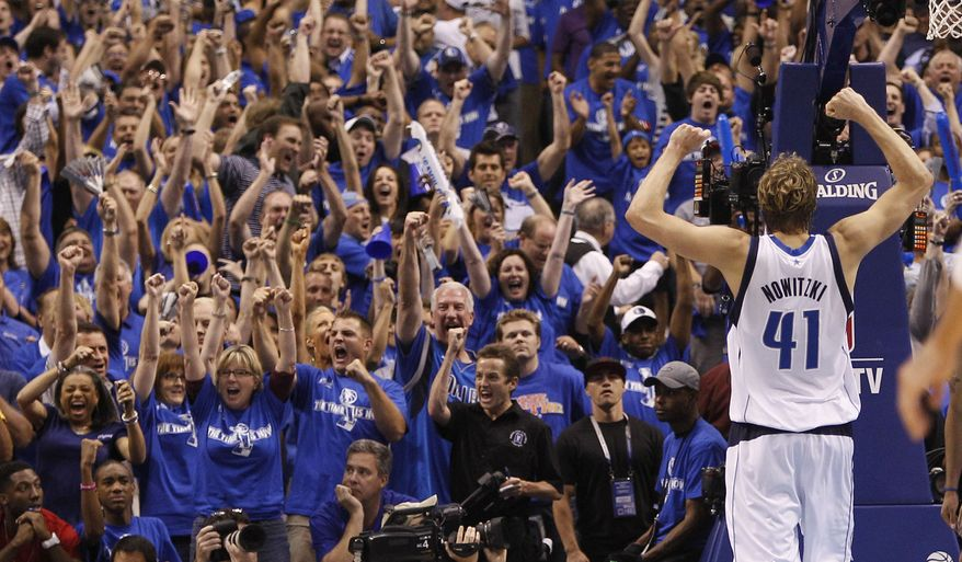 NBA Playoffs: Dallas Mavericks forward Dirk Nowitzki (41) holds up his arms as fans cheer during the final seconds of Game 5 of the NBA basketball Western Conference finals against the Oklahoma City Thunder Wednesday, May 25, 2011, in Dallas. The Mavericks won 100-96 and advanced to the NBA finals. (AP Photo/Eric Gay)