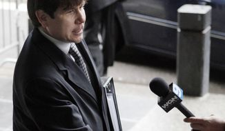 ** FILE ** Ousted Illinois Gov. Rod Blagojevich arrives at federal court in Chicago on Thursday, May 26, 2011, before taking the stand in his second corruption trial. (AP Photo/M. Spencer Green)