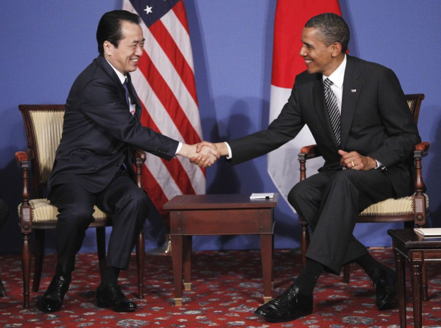 President Obama meets with Japanese Prime Minister Naoto Kan at the G-8 summit in Deauville, France, on Thursday, May 26, 2011. (AP Photo/Charles Dharapak)