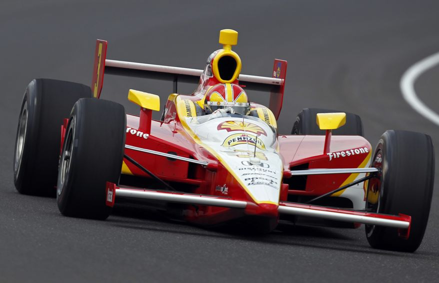 IndyCar driver Helio Castroneves, of Brazil, drives through the first turn during practice for the Indianapolis 500 at the Indianapolis Motor Speedway, Thursday, May 19, 2011, in Indianapolis. (AP Photo/Michael Conroy)