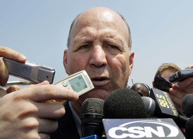 NHL Playoffs: Boston Bruins head coach Claude Julien speaks to reporters upon the team's arrival at Hansom Field in Bedford, Mass., Thursday, May 26, 2011. The Bruins host Game 7 of the NHL Stanley Cup playoffs Eastern Conference final against the Tampa Bay Lightning on Friday. (AP Photo/Elise Amendola)