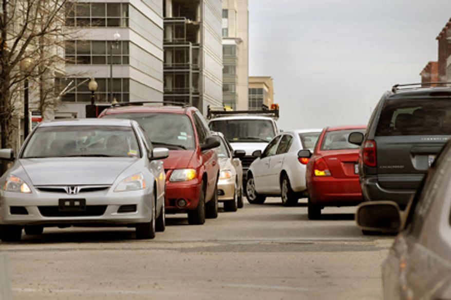 **FILE** Cars back up in both directions waiting to make left hand turns from M Street onto South Capitol Street in Southeast. (The Washington Times)