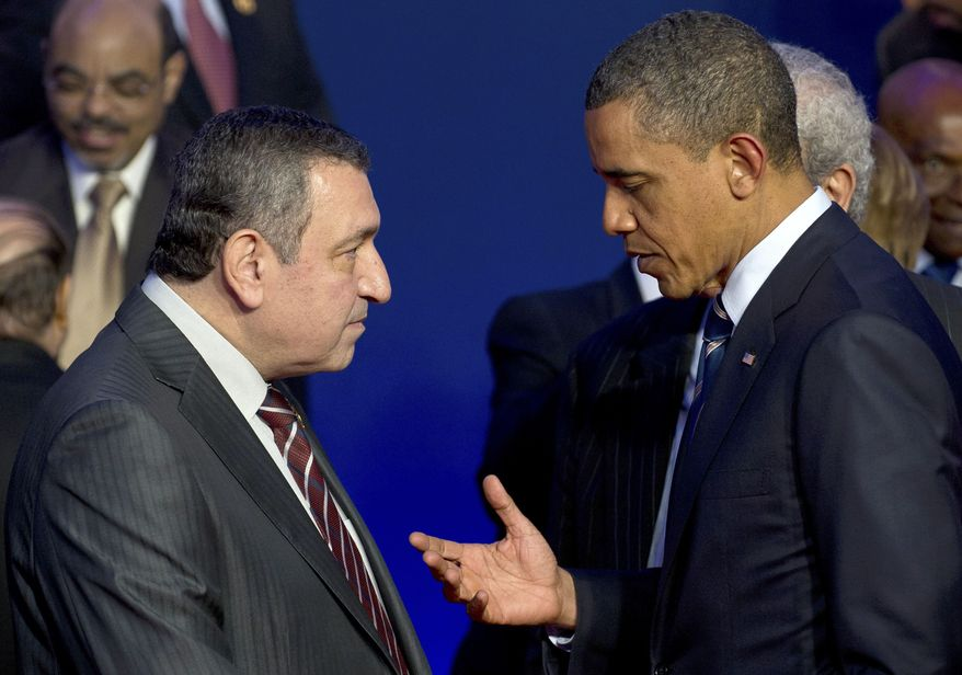 President Obama (right) speaks with Egyptian Prime Minister Essam Sharaf during a group photo at the G8 summit in Deauville, France, on May 27, 2011. (Associated Press/dapd/Peer Grimm)