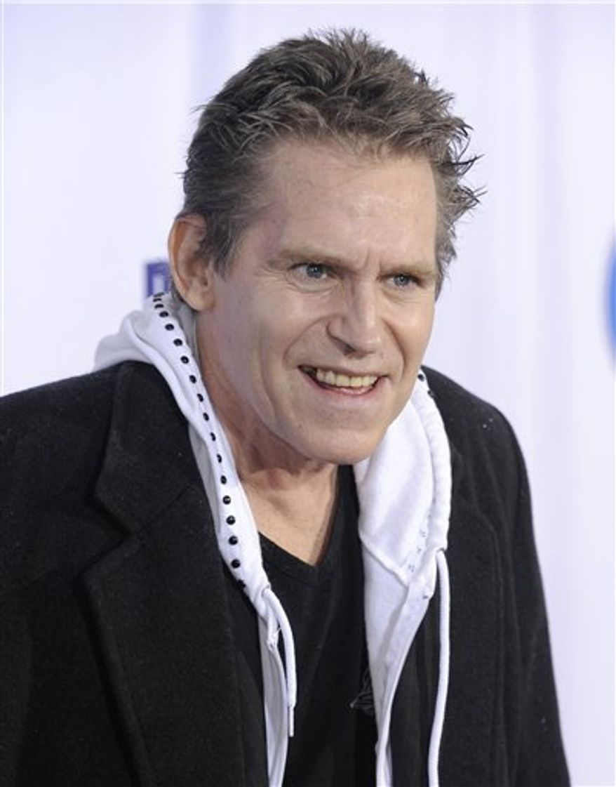 "In this Oct. 13, 2009 file photo, Jeff Conaway arrives at the 2009 Fox Reality Channel Really Awards in Los Angeles. Conaway, who starred in ""Taxi"" and played Danny Zuko's buddy Kenickie in 1978's ""Grease,"" has died at a Los Angeles area hospital. He was 60. (AP Photo/Chris Pizzello, File)"