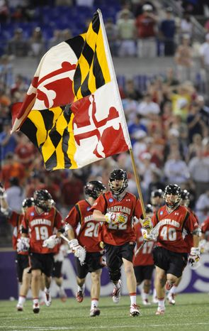 NCAA lacrosse: Maryland's Mark White runs with the state flag after defeating Duke 9-4 in the NCAA college men's Division I lacrosse semifinal game. (AP Photo/Gail Burton)