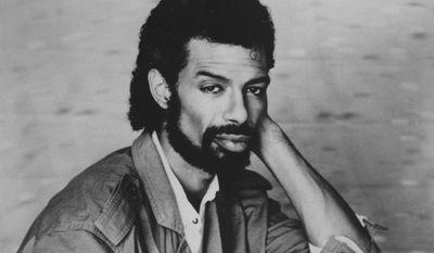 ** FILE ** This Sept. 1984, file photo shows musician Gil Scott-Heron. (AP Photo, File)