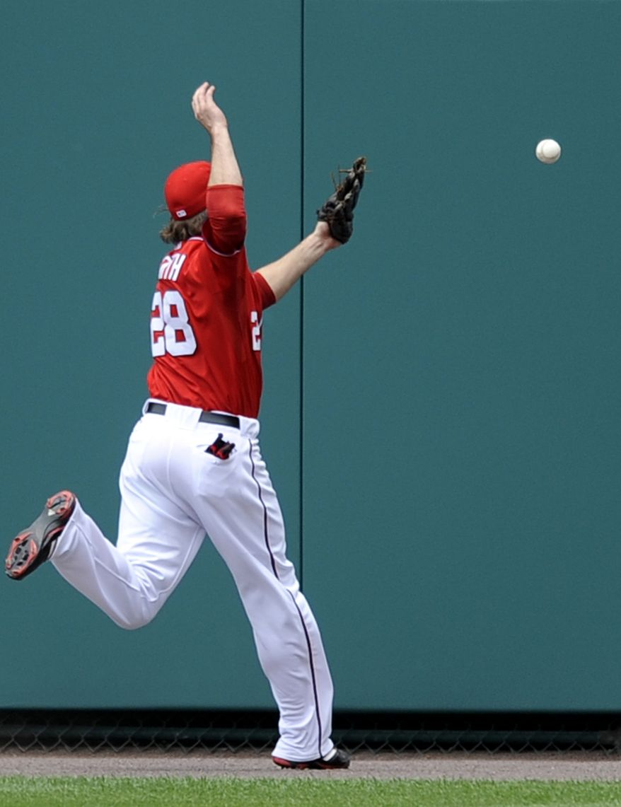Washington Nationals right fielder Jayson Werth attempts but can't get to a ball, hit for a triple by San Diego Padres' Blake Tekotte during the fourth inning. The Padres won 2-1. (AP Photo/Nick Wass)