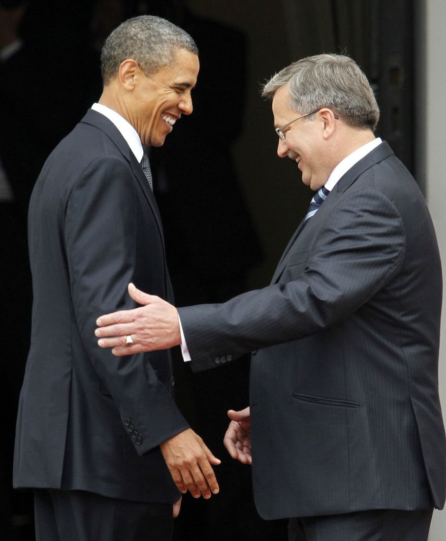 The President of the United States Barack Obama,left, and Polish President Bronislaw Komorowski take part in an arrival ceremony at the Presidential Palace in Warsaw, Saturday, May 28, 2011. Obama came to Poland for a two day visit. (AP Photo/Czarek Sokolowski)