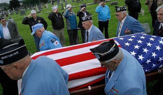 The flag-covered casket of Artie Hodapp is carried by Korean War veterans at the St. Joseph's cemetery during funeral services in Freeport, Ill., on Wednesday. More than half a century after he died in Korea, the bones of the young soldier are returned after being matched with relatives' DNA. (Associated Press)