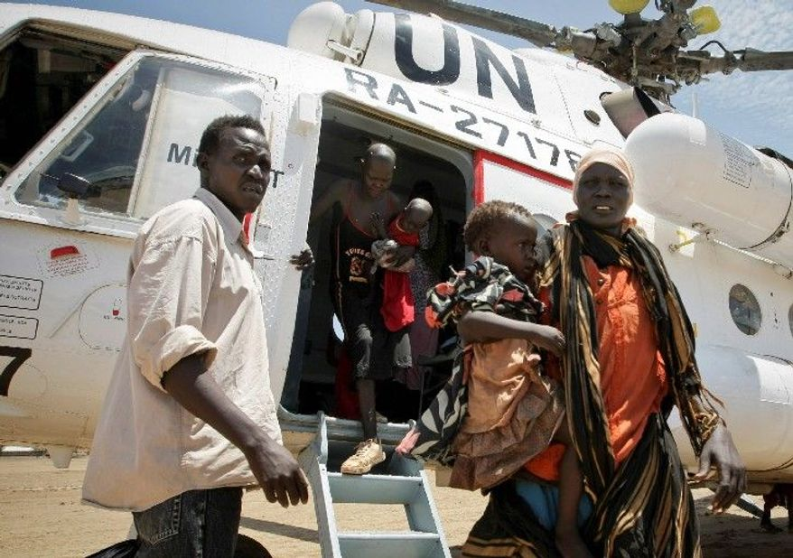 Dinka Ngok civilians needing medical assistance, some suffering from gunshot and machete wounds, who were internally displaced as a result of the recent Sudanese conflict, arrive in the town of Turalei after being airlifted from Abyei by U.N. helicopter. (Associated Press)