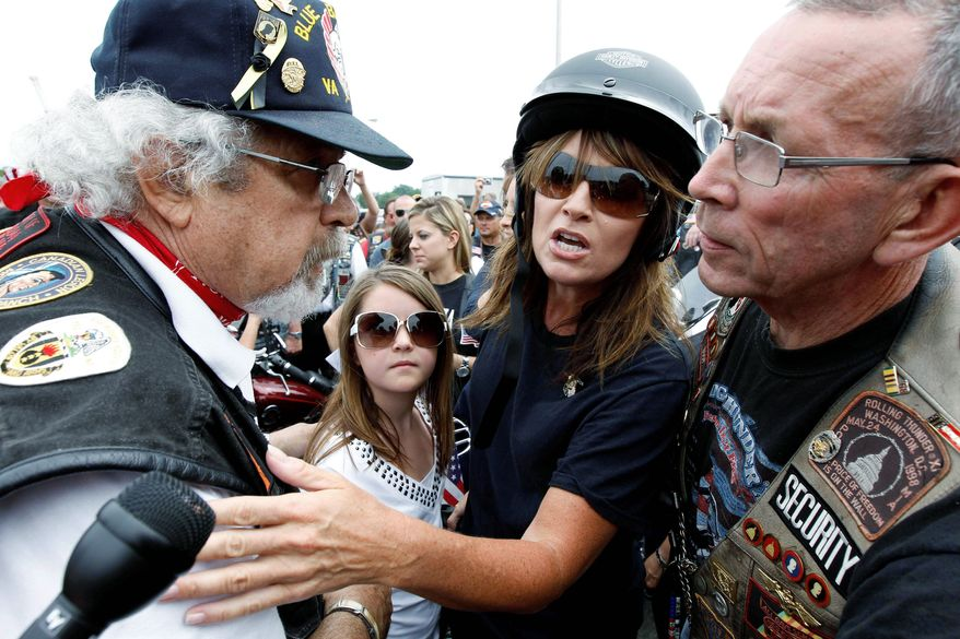 Sarah Palin, with her daughter Piper (center), answers a reporter's question at the beginning of the Rolling Thunder motorycycle ride at the Pentagon on Sunday. She smiled broadly when many in the crowd urged her to run for the presidency.