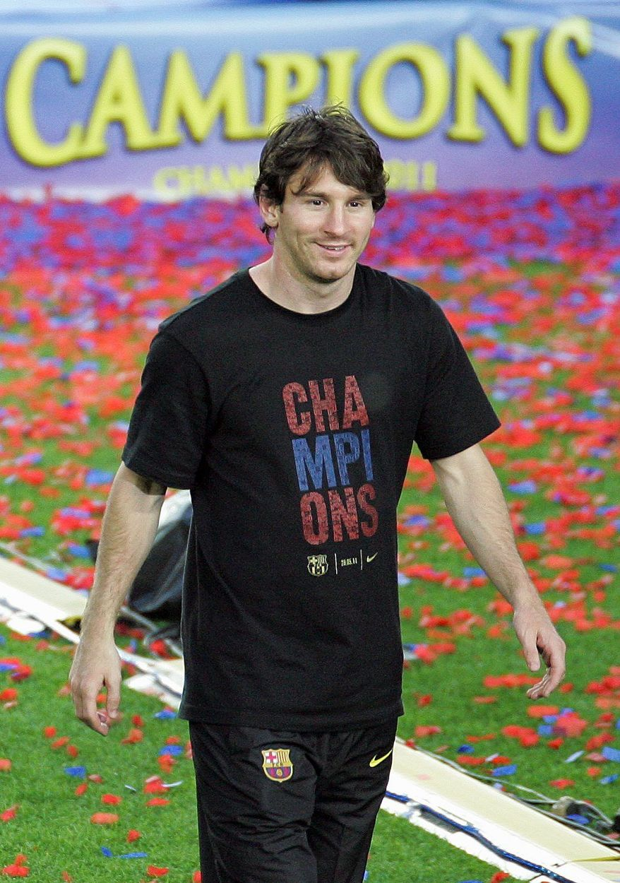 FC Barcelona Lionel Messi, from Argentina, looks on after winning the Champions League soccer title at the Camp Nou stadium in Barcelona city, Sunday, May 29, 2011. (AP Photo/Job Vermeulen)