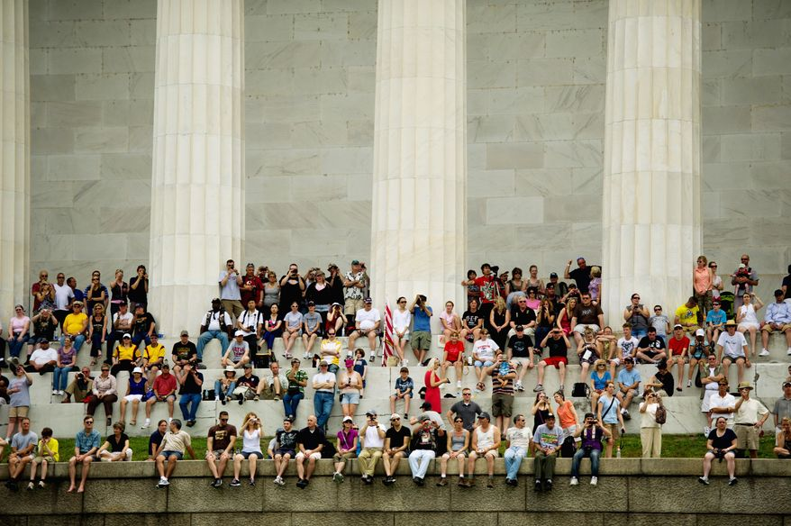 "A crowd gathered at the Lincoln Memorial watches the bikers of the Rolling Thunder motorcycle rally ride across Memorial Bridge on Sunday. ""I always come here,"" Iraq veteran Staff Sgt. Scot Dellmore said. ""You can't beat D.C. You can't beat the crowd of bikes."""
