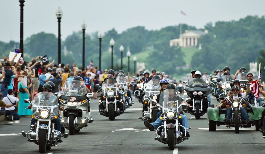Bikers in the Rolling Thunder motorcycle rally ride across Memorial Bridge on Sunday. The 24th annual event, which saw thousands of military and civilian motorcycle riders rumble across the District, was held to remember American prisoners of war and support veterans. (Drew Angerer/The Washington Times)