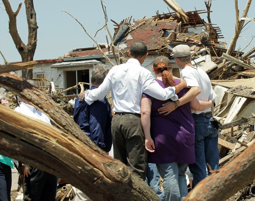 President Obama embraces residents of Joplin, Mo., while viewing the devastation caused by a May 22 tornado that left more than 130 people dead. Mr. Obama promised the nation will not forget the city and its people. (Associated Press)