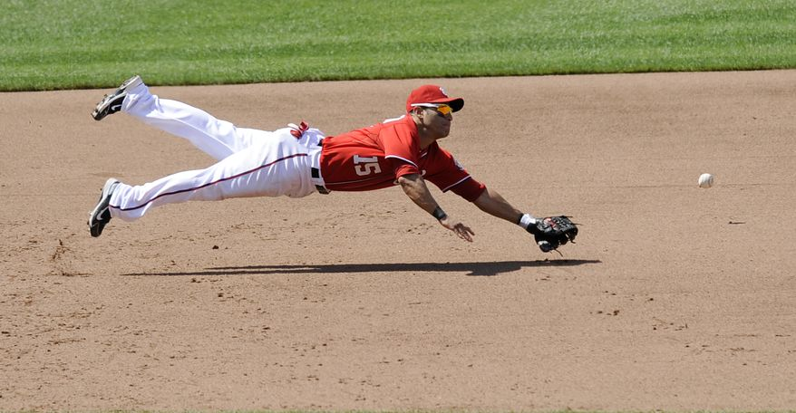 ** FILE ** Washington Nationals third baseman Jerry Hairston Jr. dives in vain for a ball hit by Logan Forsythe of the San Diego Padres for a single during the ninth inning of a baseball game on Saturday, May 28, 2011, in Washington. The Padres won 2-1. (AP Photo/Nick Wass)