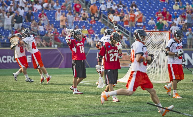 The Virginia Cavaliers exult Monday over their first national lacrosse title since 2006 as the loss sinks in for the Maryland Terrapins at the 2011 NCAA lacrosse final at Baltimore's M&T Bank Stadium. (Rod Lamkey Jr./The Washington Times)