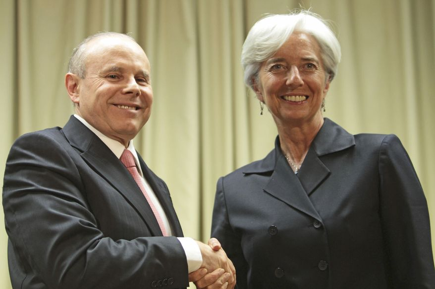 Brazilian Economy Minister Guido Mantega welcomes French Finance Minister Christine Lagarde, the front-runner for chief of the International Monetary Fund. Brazil is one of several countries that wants the IMF search to go outside of Europe. (Associated Press)