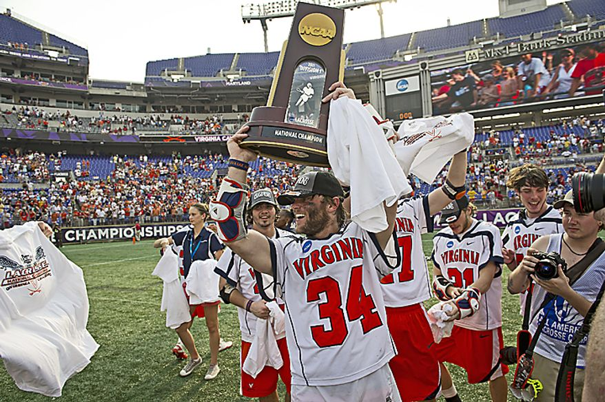 Colin Briggs (34) hoists the trophy after the Cavaliers' victory over the Maryland Terrapins for the 2011 NCAA Lacrosse Championship at M & T Bank Stadium in Baltimore, Md., Monday, May 30, 2011. The Virginia Cavaliers defeated the Maryland Terrapins 9-7. (Rod Lamkey Jr./The Washington Times)