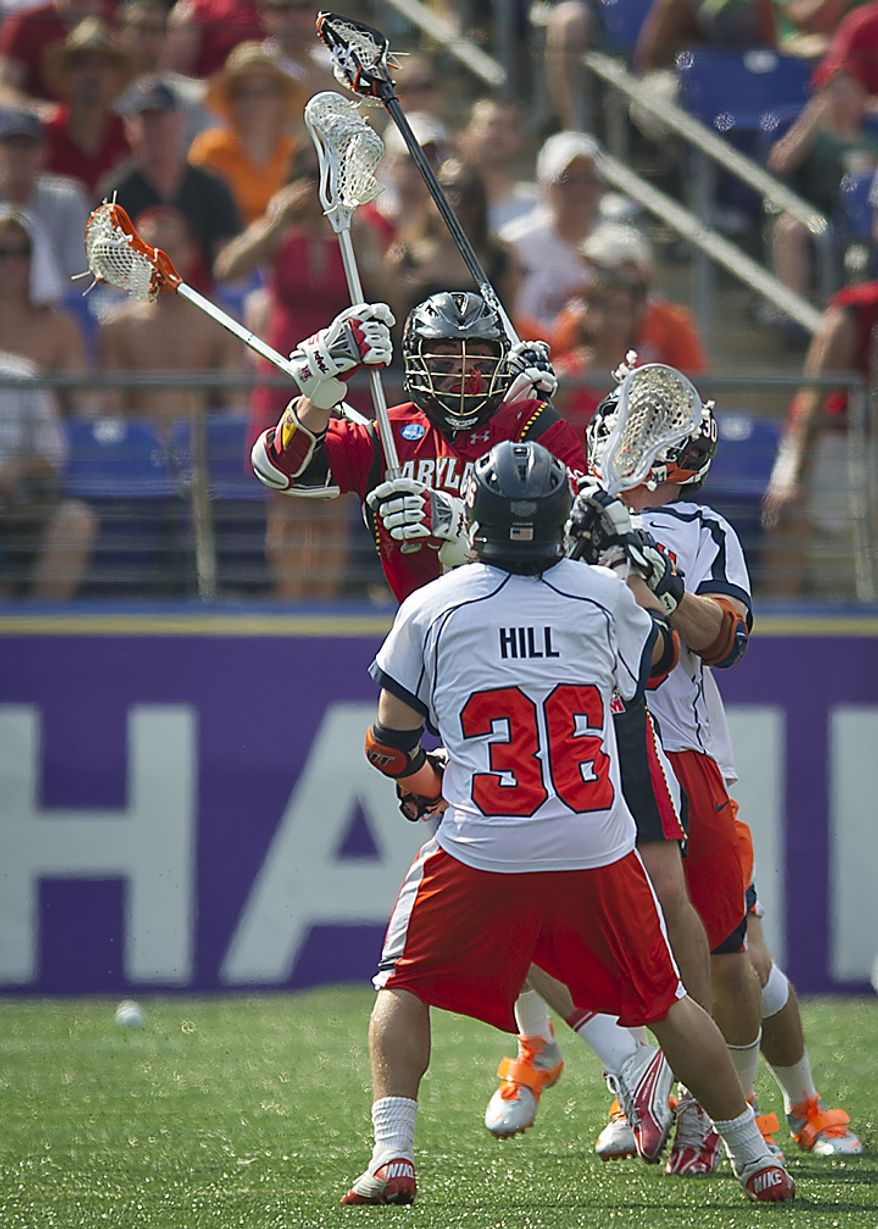 Grant Catalino (1) of the Maryland Terrapins is smashed in between Bobby Hill (36) and Bray Malphrus (30) of the Virginia Cavaliers in the first quarter during the 2011 NCAA Lacrosse Championship at M & T Bank Stadium in Baltimore, Md., Monday, May 30, 2011. (Rod Lamkey Jr./The Washington Times)