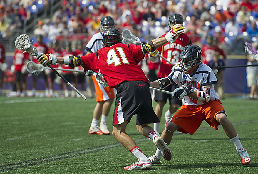 Kevin Cooper (41) of the Maryland Terrapins tries to navigate past Colin Briggs (34) of the Virginia Cavaliers in the first quarter during the 2011 NCAA Lacrosse Championship at M & T Bank Stadium in Baltimore, Md., Monday, May 30, 2011. (Rod Lamkey Jr./The Washington Times)