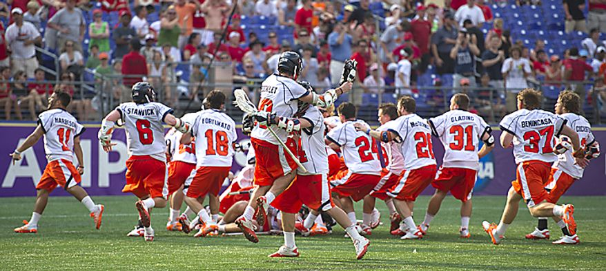 The Virginia Cavaliers celebrate their victory over the Maryland Terrapins for the 2011 NCAA Lacrosse Championship at M & T Bank Stadium in Baltimore, Md., Monday, May 30, 2011. The Virginia Cavaliers defeated the Maryland Terrapins 9-7. (Rod Lamkey Jr./The Washington Times)