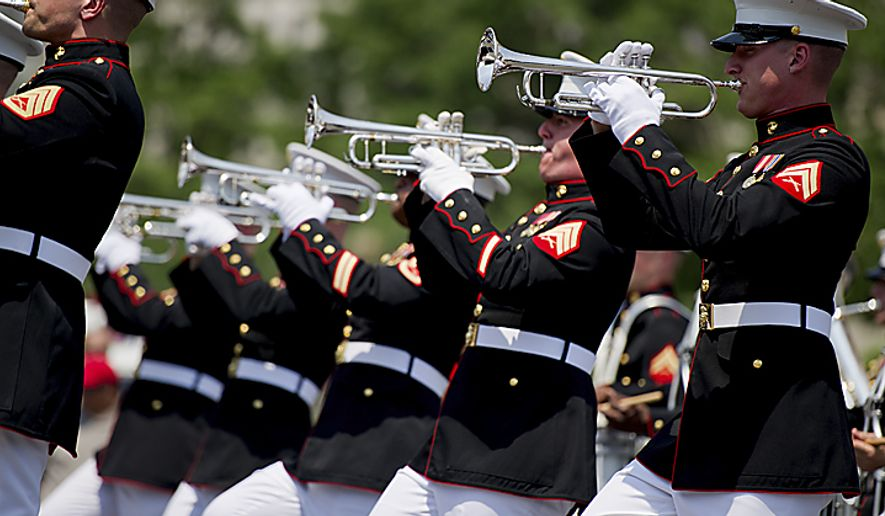 Members of the U.S. Marine Corps Band from Quantico, Va., march down Constitution Avenue during the National Memorial Day Parade, in Washington, D.C., Monday, May 30, 2011. (Drew Angerer/The Washington Times) ** FILE **