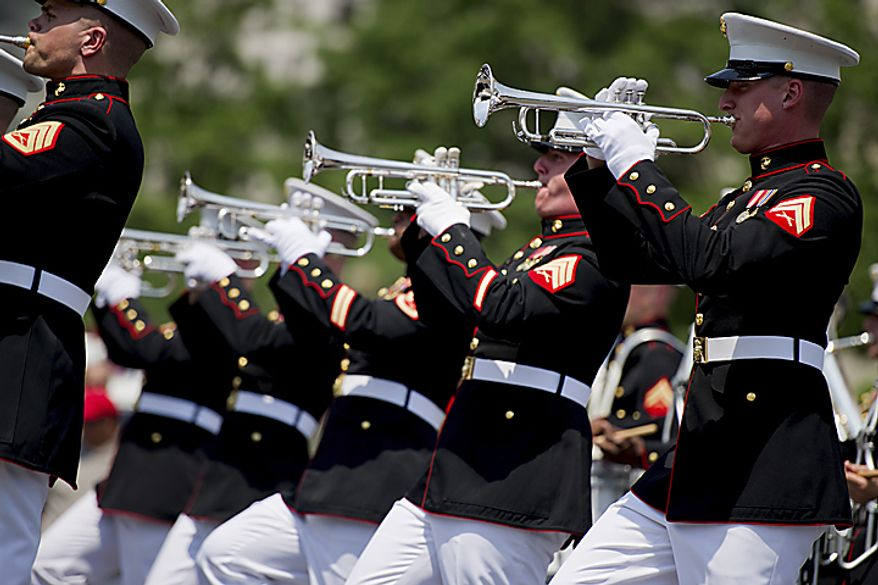 Members of the U.S. Marine Corps Band from Quantico, Va. march down Constitution Avenue during the National Memorial Day Parade, in Washington, D.C., Monday, May 30, 2011. (Drew Angerer/The Washington Times)