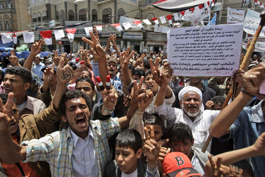 Anti-government protesters shout slogans during a demonstration demanding the resignation of Yemeni President Ali Abdullah Saleh in Sanaa, Yemen, the nation's capital, on Sunday, May 29, 2011. (AP Photo/Hani Mohammed)