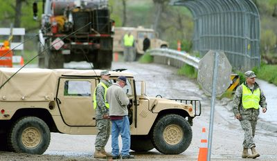 ** file photo ** Montana National Guard soldiers man checkpoints in Crow Agency, Mont.  (AP Photo/The Billings Gazette, Larry Mayer)