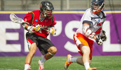 ROD LAMKEY JR./THE WASHINGTON TIMES Virginia sopohomore Matt White, defended by Maryland's Dan Burns in the NCAA title game Monday, scored 12 of his 27 points during the Cavaliers' five-game winning streak to end the season.