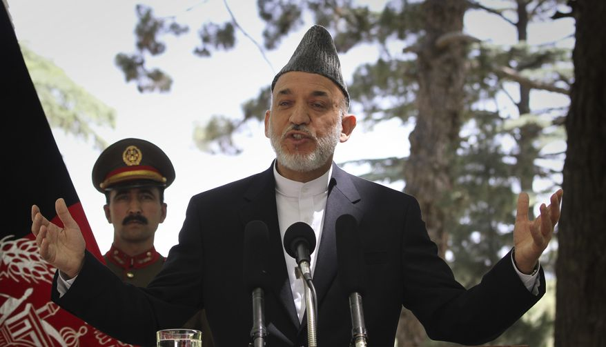Afghan President Hamid Karzai gestures during a press conference at the Presidential Palace in Kabul, Afghanistan, on Tuesday, May 31, 2011. Angered by civilian casualties, Mr. Karzai said he no longer will allow NATO airstrikes on houses. (AP Photo/Musadeq Sadeq)