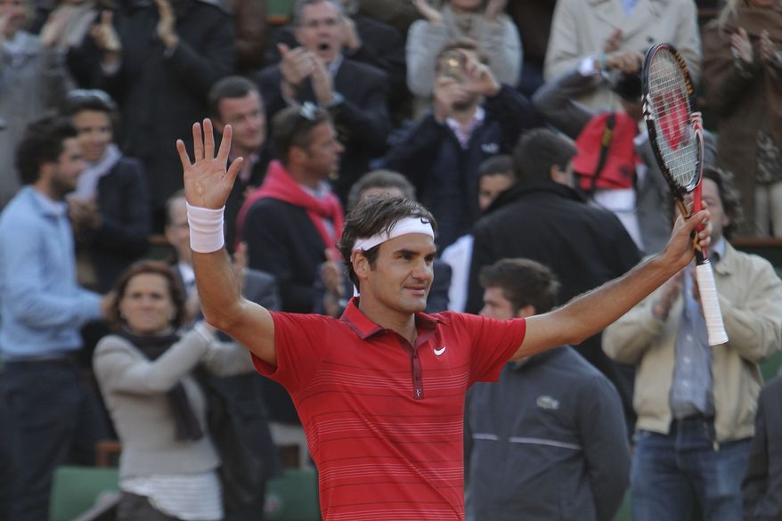 Roger Federer of Switzerland celebrates his victory over Gael Monfils of France in the quarter final match of the French Open tennis tournament in Roland Garros stadium in Paris, Tuesday May 31, 2011. Federer won the match in three sets 6-4, 6-3, 6-7. (AP Photo/Michel Euler)