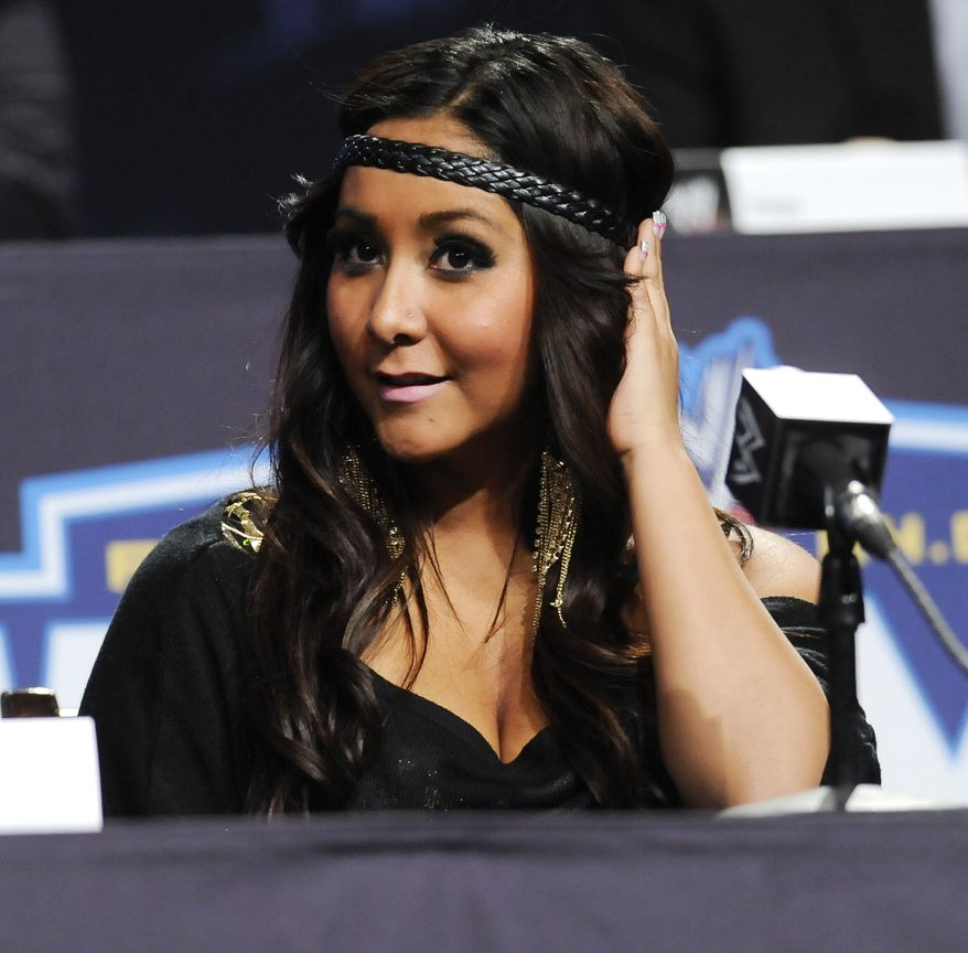 "**FILE** In this photo from March 30, 2011, reality television star Nicole ""Snooki"" Polizzi participates in a Wrestlemania XXVII news conference at the Hard Rock Cafe in New York. (Associated Press)"